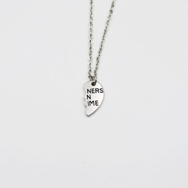 silver partners in crime broken heart necklace